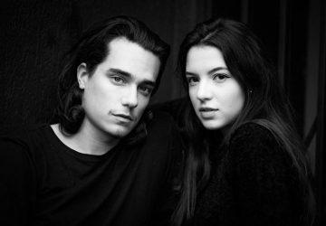 man och kvinna i svarta skjortor