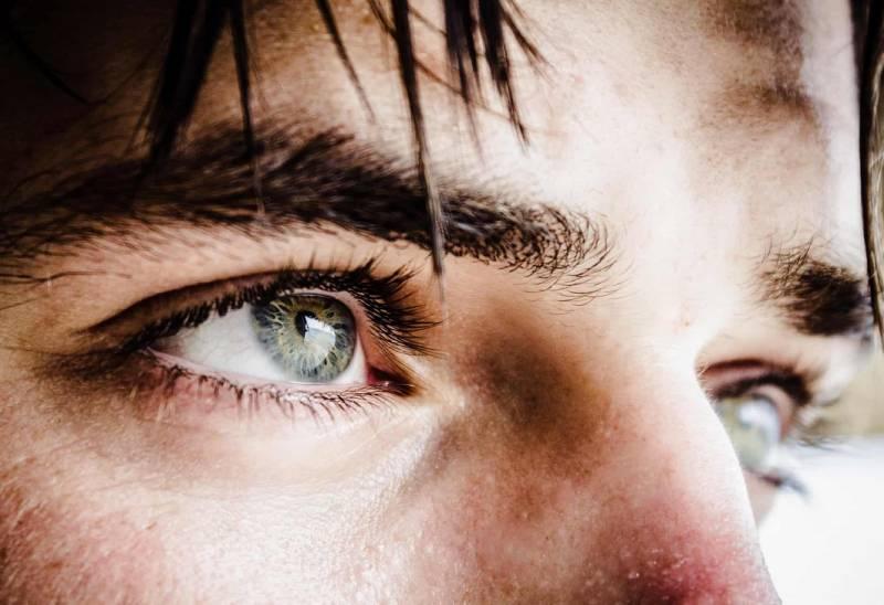närbild foto av människans blå ögon