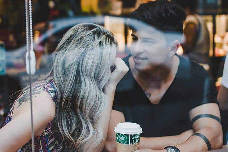 man and woman at starbucks