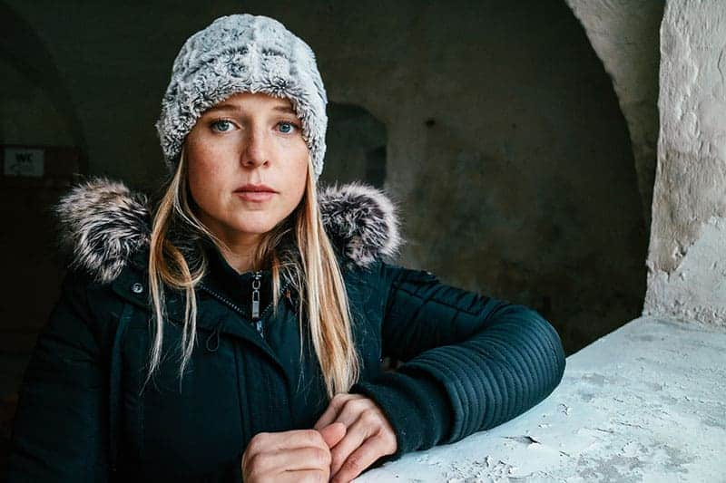 blonde woman with winter cap