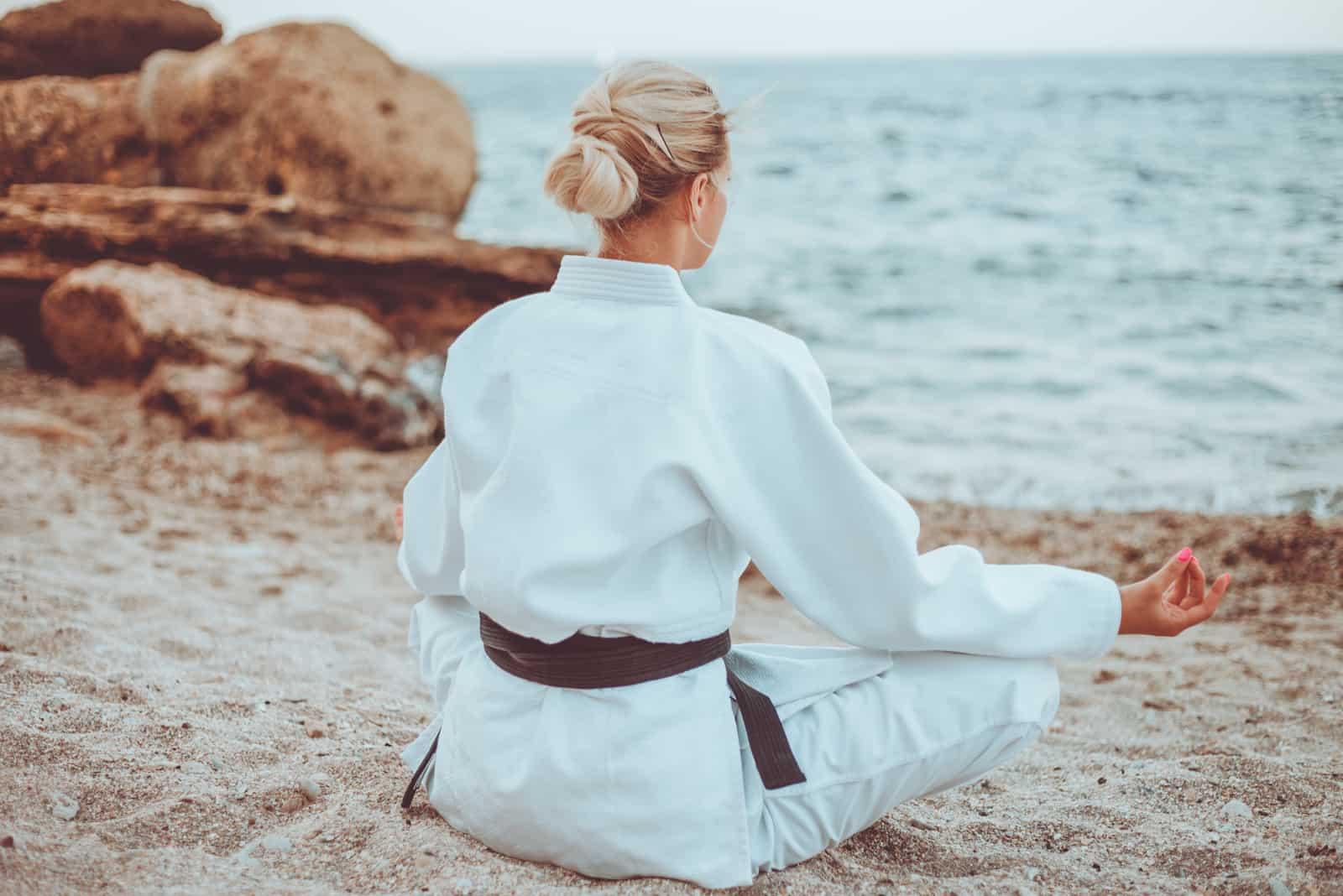 attractive karate woman in white kimono